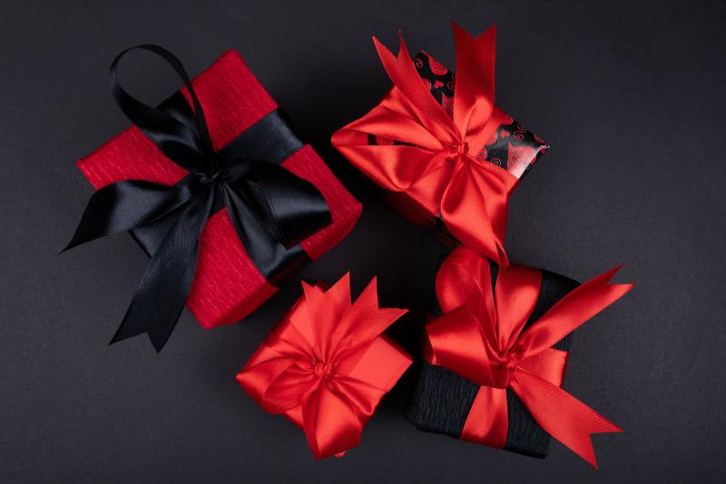 red and black gift wrapped , gift boxes